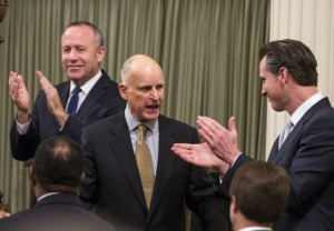 Darrell Steinberg, California Senate President Pro Tempore, Jerry Brown, governor of California,  Gavin Newsom, lieutenant governor of California via Getty Images